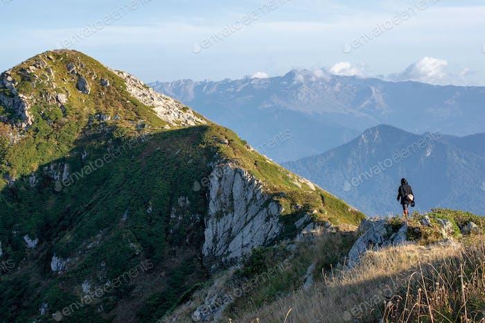Hiking girl in the mountain