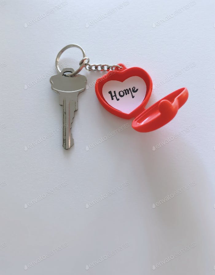 Minimal. New home key in heart keychain with the word home inside of it. Bucket list. New beginnings