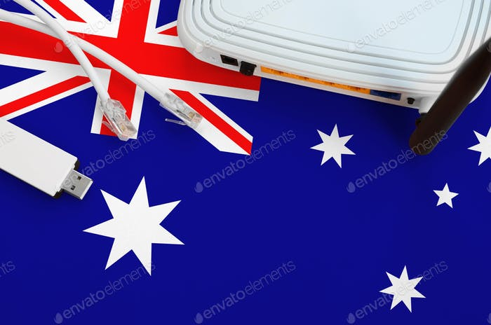 Australia flag depicted on table with internet rj45 cable, wireless usb wi-fi adapter and router