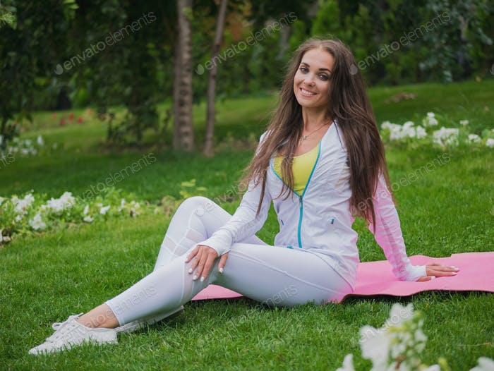 Portrait of woman in sportswear in park