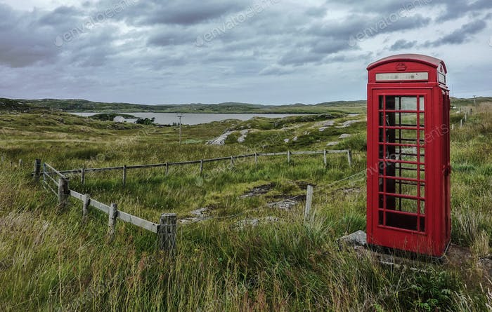Old British telephone box - this one stands in spectacular scenery in the Outer Hebrides of Scotland