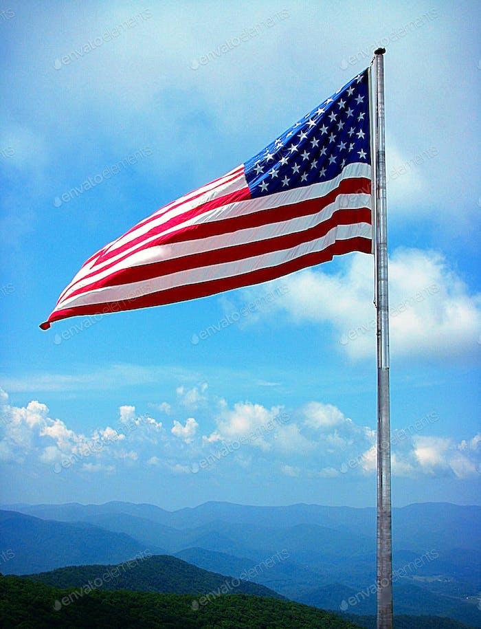American flag against smokey mountains
