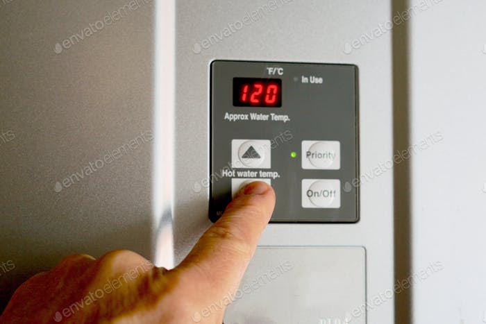 Finger on hot water heater control unit