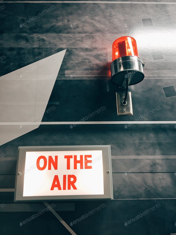 """""""On The Air"""" sign inside a television studio."""