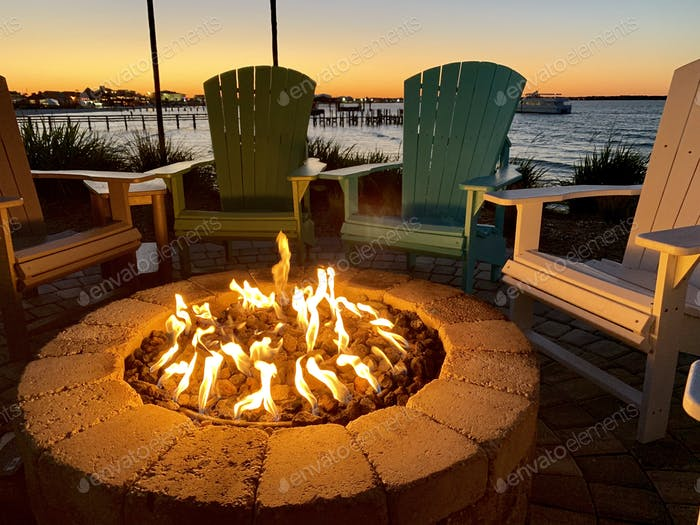 Fire pit by the bay at sunset