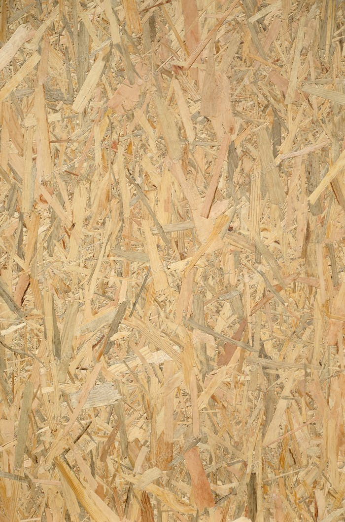 Pressed wooden OSB panel background. Vertical texture of oriented strand board close up