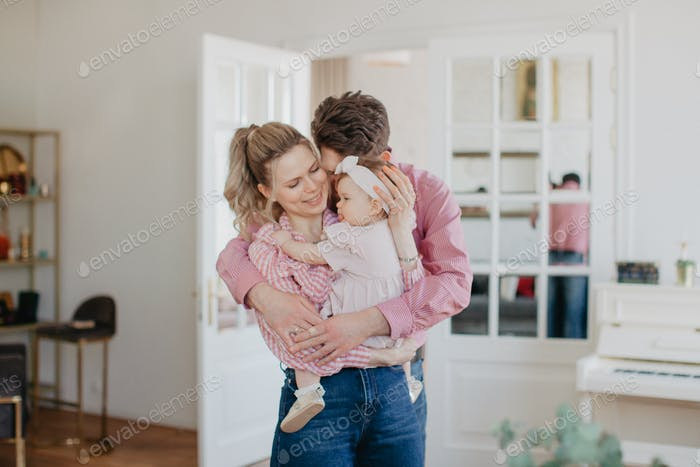 Family at home is hugging