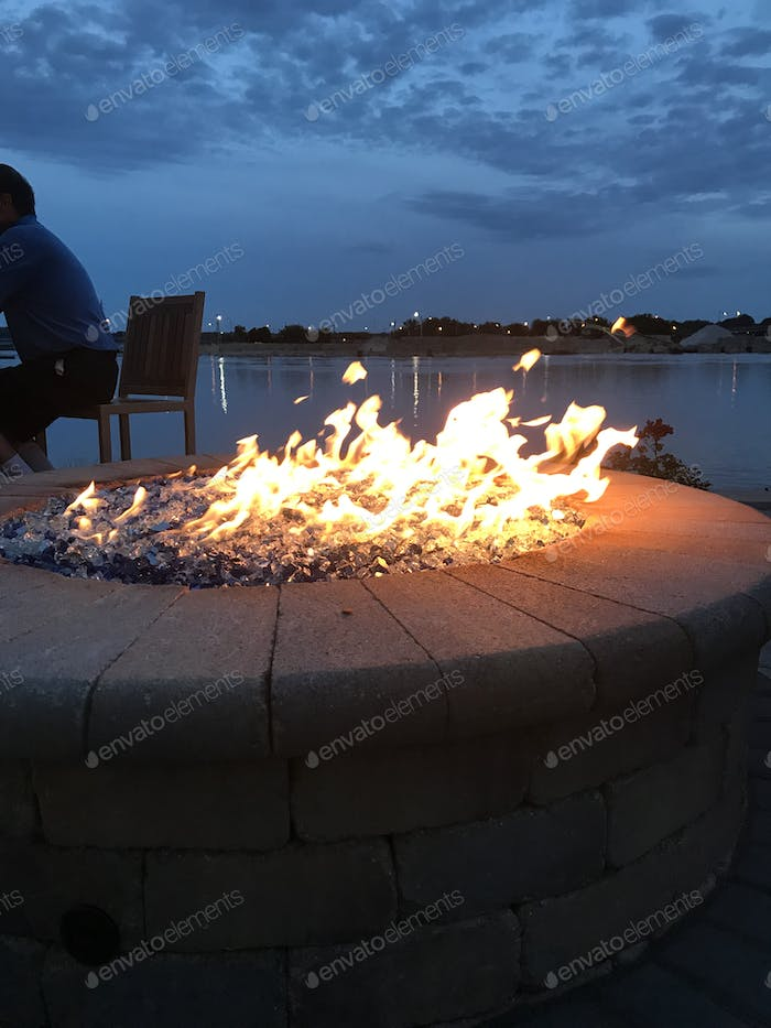 Fire pit on the patio at the lake