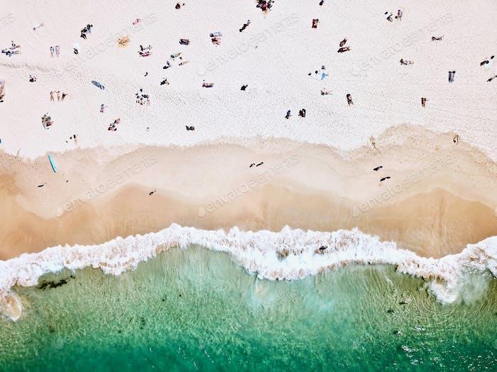 An aerial shot of a sandy beach shot by drone.