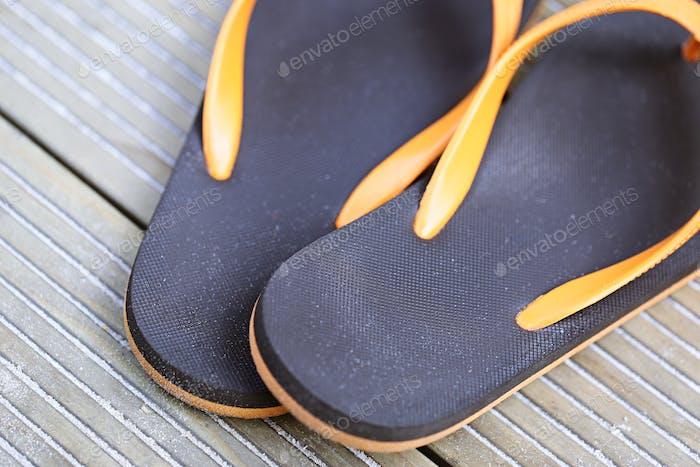 Beach sandals on closeup on wooden floor background