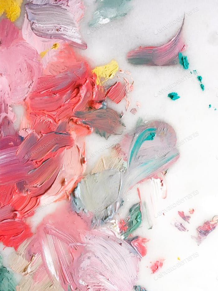 Bright bold paint smears on a palette.