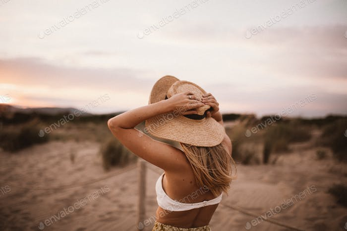 A girl on the beach in beautiful hat