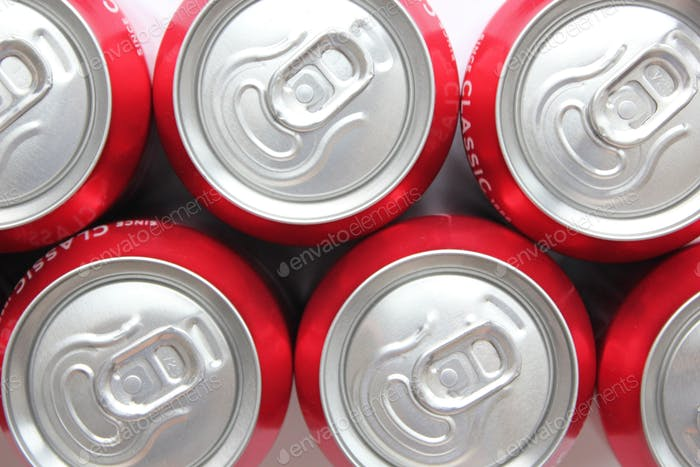 Close up of the ring pulls on aluminium Coca Cola soda cans flat lay style