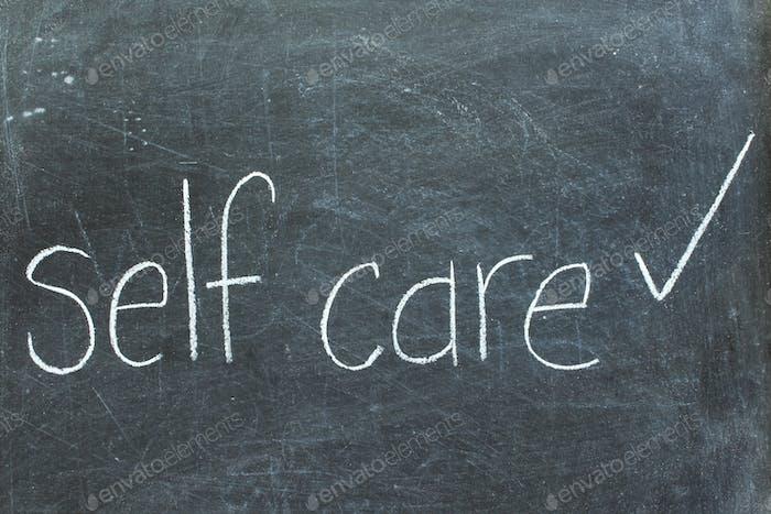 Self care on chalkboard