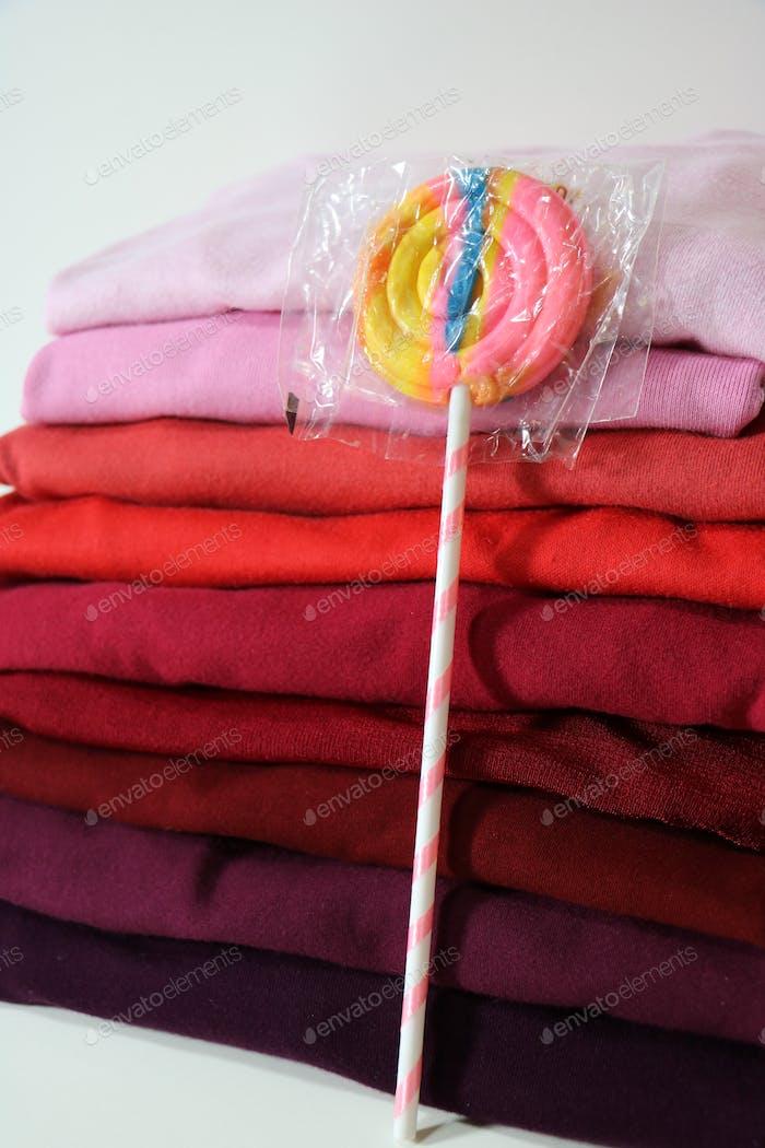 folded laundry and a treat