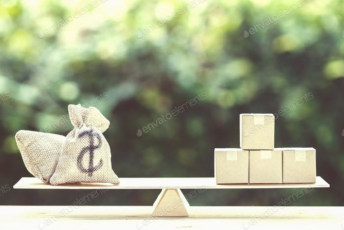 Money and supply concept : Money dollar bag and supply products on balance scale on wooden table