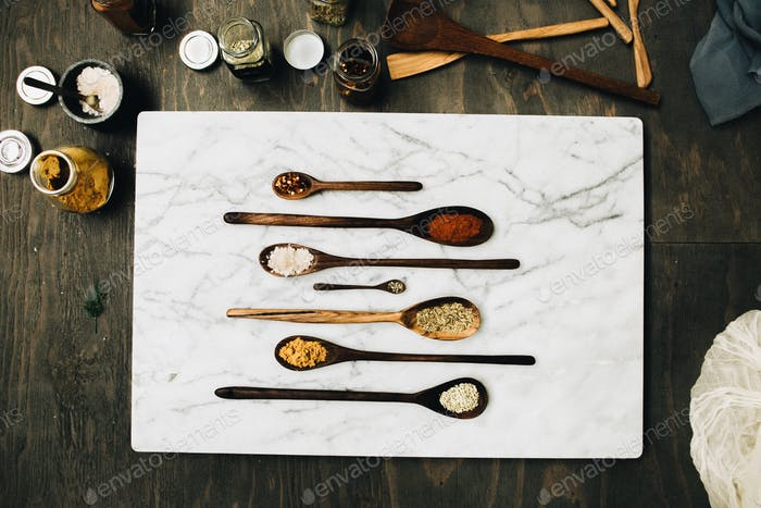 Hand crafted spoons with herbs and spices