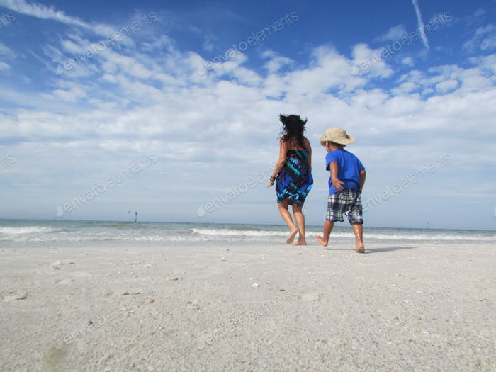 Fiston & I walking on the beach ..looking for seashells!!