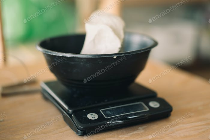 Clay being weighted in the scales