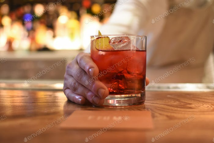 A close up of a negroni at the bar